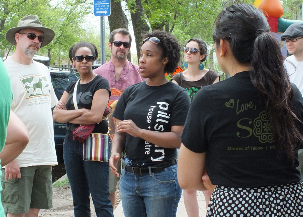 Michelle Barnes shares a story of the neighborhood on a StoryWalk.