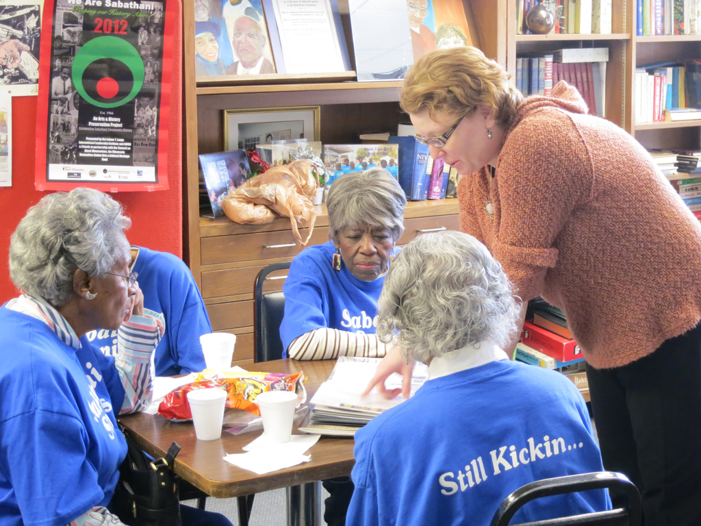 Artist Patricia Anderson shares the collages with senior at the Senior Center at Sabathani Community Center