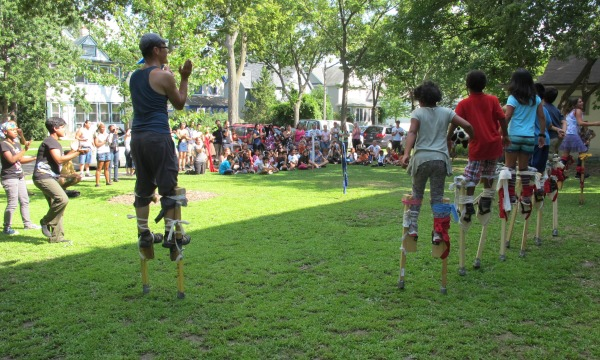 Stilting youth from Pillsbury House's Summer Arts Camp