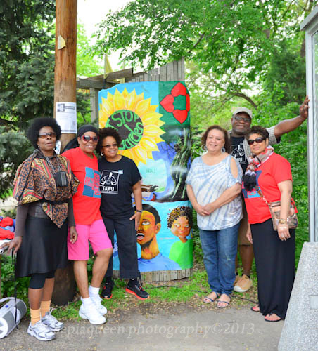 TAWU artists at the unveiling of the new painting in the ArtStop garden on 32nd and Chicago; photo by Stephanie D. Morris