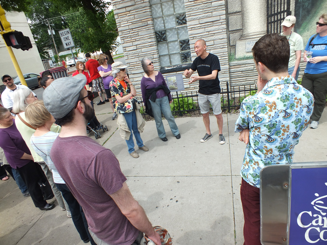 Wing Young Huie leading a walking tour at the June 8th Arts on Chicago Celebration