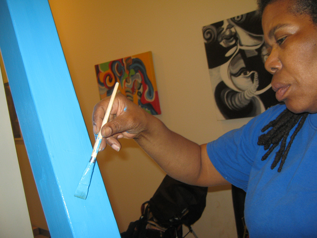 Loretta Day, TAWU Coordinator, working on her Soul Pole.